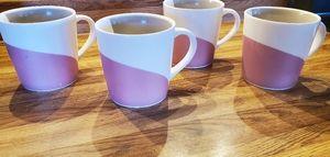 Pink, Grey and white Starbucks coffee mugs.